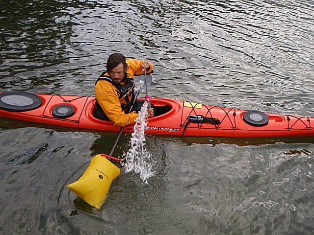Kayaker using a paddlefloat
